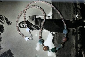 Perhaps something a little earthier like this Jasper and glass bead necklace